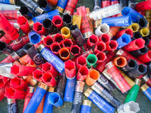 Empty cartridges collected in a skeet shooting range. Stock Photo