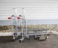 Empty carts for large purchases. In the supermarket Royalty Free Stock Image