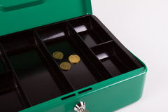 Empty cash box with only little coins. Empty green cash box with little coins after shopping or end of month Stock Image