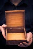 Empty casket hands man Stock Photography