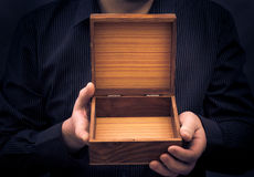 Empty casket hands man Royalty Free Stock Images