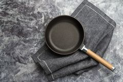Free Empty Cast Iron Frying Pan On Dark Grey Culinary Background, View From Above Royalty Free Stock Image - 150813366