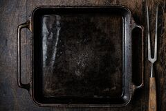 An empty cast iron or iron pan for baking food in the oven