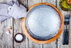 Empty cast-iron pan on a wooden background Royalty Free Stock Image
