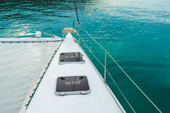 Empty catamaran yacht deck sailing on the sea Royalty Free Stock Photography