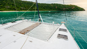 Empty catamaran yacht deck sailing on the sea Stock Images