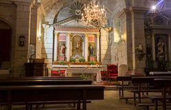Free Empty Catholic Cathedral. Church Altar With Chandelier, Saint Sculptures And Benches. Church Interior With Altar. Stock Image - 133429321