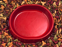 Empty cats or dogs bowl on the background of dry pet food Royalty Free Stock Image