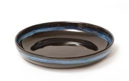 Empty ceramic black bowl Stock Images