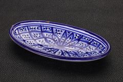 Empty ceramic bowl. Over black background royalty free stock image