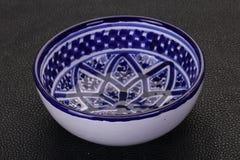 Empty ceramic bowl. Over black background stock photos