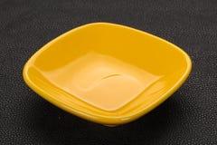 Empty ceramic bowl. Over black background stock images