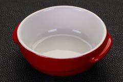 Empty ceramic bowl. Over black background stock image