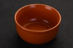 Empty ceramic bowl. Over black background stock photo