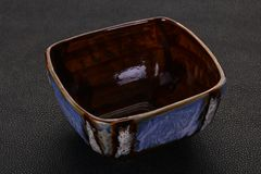 Empty ceramic bowl. Over black background stock photography