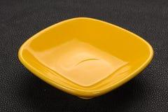 Empty ceramic bowl. Over black background royalty free stock photo