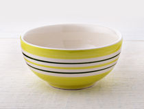 Empty ceramic bowl on wood Stock Images