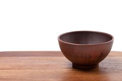 Empty ceramic bowl on wooden kitchen table Stock Photography