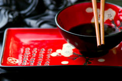 Empty ceramic Chinese dish and chopsticks Stock Images