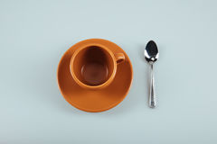 Empty ceramic coffee cup on saucer with silver teaspoon Stock Photos