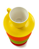 Empty ceramic cup and saucer on white Royalty Free Stock Images