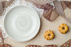 Empty ceramic plate with coconut biscuit and pineapple jam Royalty Free Stock Photo