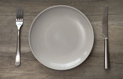Empty ceramic plate on a wooden table. Royalty Free Stock Photo