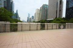 Empty ceramic tile road surface floor with city landmark buildin Stock Image