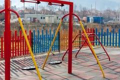 Empty chain swing. On kids playground Stock Photos