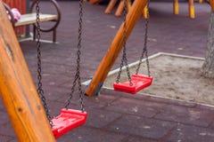 Empty chain swing. On kids playground Stock Photo