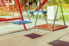 Empty chain swing in playground close Royalty Free Stock Image