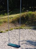 Empty chain swing in playground. Nobody sit on swing in playground stock image