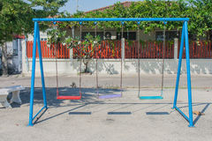 Empty chain swing in playground. Stock Photos