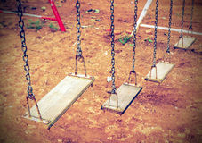 Empty chain swing in playground. Vintage filter Royalty Free Stock Photo