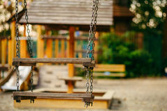 Empty chain swings on playground in the public park Stock Photo