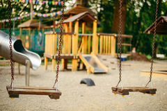 Empty chain swings on playground in the public park Royalty Free Stock Images