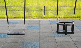 Empty chain swings on playground Royalty Free Stock Images