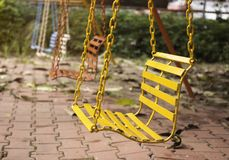Empty chain swings in playground with vintage filter Stock Image