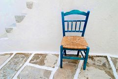 Empty chair. Wooden chair on stone path in Greece Stock Photos