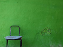 Empty chair. Chair on a green wall Stock Photos