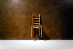 Empty chair against the wall. Levitating a chair against the wall Royalty Free Stock Photography