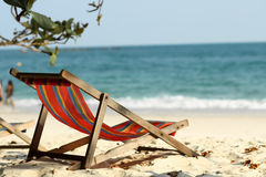 A empty chair on the beach Royalty Free Stock Image