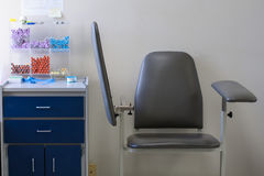Empty chair and blood-drawing supplies in medical lab Royalty Free Stock Images