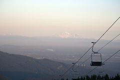 Empty chair lifts at ski resort Royalty Free Stock Images