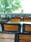Empty chair. Outdoor cafe empty minimalist modern tree clean Stock Photos