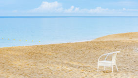 An empty chair on a sandy beach near the sea Royalty Free Stock Photo