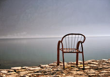 Empty chair at the sea. On sunrise Stock Photo