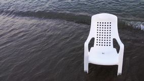 Empty chair in the sea. Video stock video