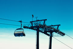 Empty chair ski lift over blue sky in the evening Royalty Free Stock Photos