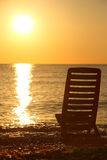 Empty chair stands sideways on sea-shore Royalty Free Stock Photography